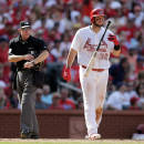 St. Louis Cardinals' Matt Adams, right, tosses his bat after being called out on strikes by home plate umpire Lance Barksdale, left, to end the fifth inning of a baseball game between the Cardinals and Arizona Diamondbacks Monday, May 25, 2015, in St. Louis. (AP Photo/Jeff Roberson)