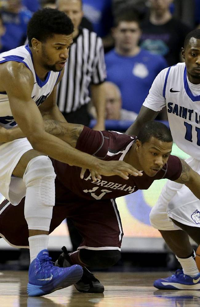 Fordham's Chris Whitehead, center, dives for a loose ball along side Saint Louis' Dwayne Evans, left, and Mike McCall Jr. during the second half of an NCAA college basketball game Saturday, Jan. 18, 2014, in St. Louis. Saint Louis won 70-48