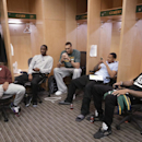 Utah Jazz players, from left, Alec Burks, Ian Clark, Rudy Gobert, Trey Burke and Malcolm Thomas talk and check their cell phones in the locker room on the day the Jazz cleaned out their lockers after a 25-57 season, Thursday, April 17, 2014, in Salt Lake