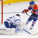 Tampa Bay Lightning goalie Ben Bishop (30) makes a save on Edmonton Oilers forward Teddy Purcell (16) during second period NHL hockey action in Edmonton, Alberta, on Monday Oct. 20, 2014 The Associated Press