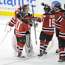 New Jersey Devils goaltender Cory Schneider celebrates with teammates Stephen Gionta (11), Travis Zajac (19) and Andy Greene (6) after the Devils defeated the Winnipeg Jets, 2-1, in a shootout during an NHL hockey game Thursday, Oct. 30, 2014, in Newark,