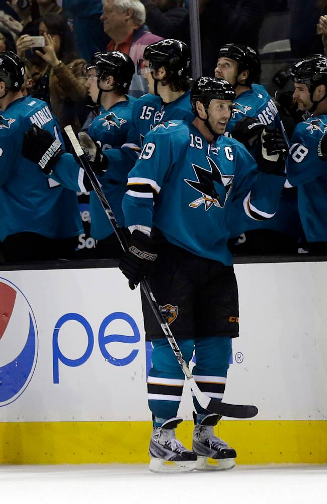 San Jose Sharks' Joe Thornton (19) celebrates his goal with teammates during the second period of an NHL hockey game against the Los Angeles Kings on Wednesday, Nov. 27, 2013, in San Jose, Calif