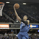 Minnesota Timberwolves guard Kevin Martin, left, drives to the basket past Sacramento Kings guard Isaiah Thomas during the first quarter of an NBA basketball game in Sacramento, Calif., Saturday, March 1, 2014 The Associated Press