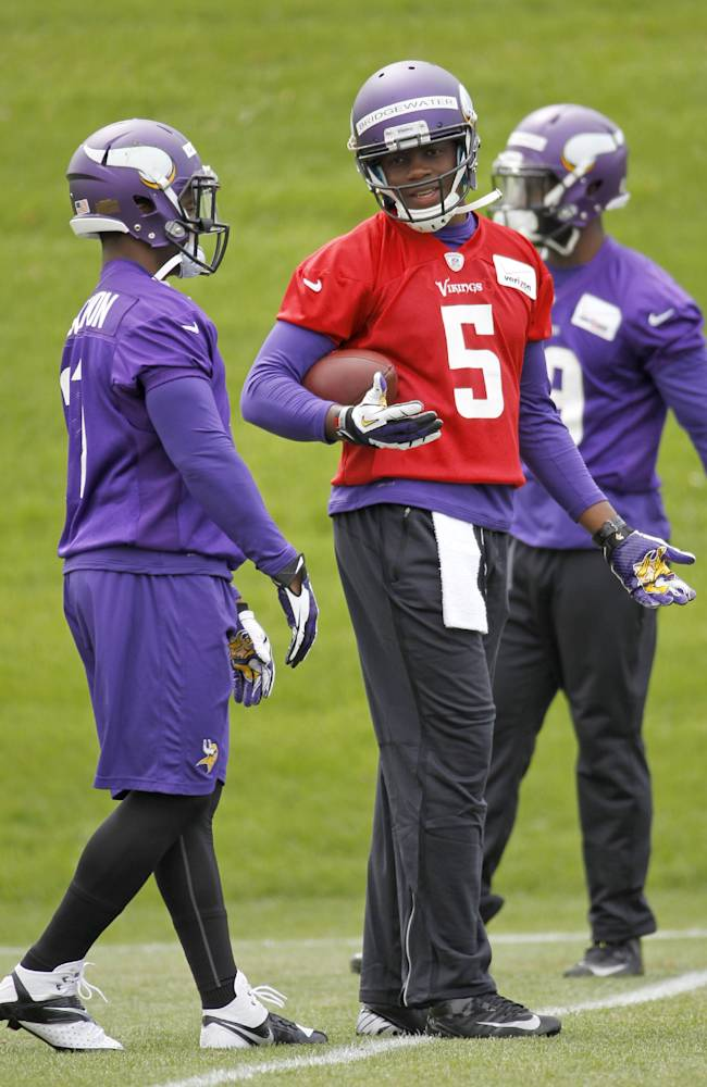 Minnesota Vikings quarterback Teddy Bridgewater (5) talks with running back Jerick McKinnon, left, during the NFL football team's minicamp in Eden Prairie, Minn., Friday, May 16, 2014.  New Vikings coach Mike Zimmer set to work getting young players like Bridgewater, linebacker Anthony Barr and defensive backs Antone Exum and Kendall James up to speed on what will be expected of them in the NFL