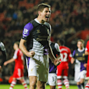Liverpool's Steven Gerrard, centre, reacts after scoring a goal from a penalty shot, during their English Premier League match against Southampton, at St Mary's, Southampton, England, Saturday March 1, 2014