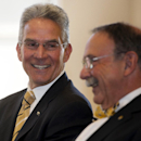 Missouri athletic director Mike Alden, left, laughs with University of Missouri chancellor R. Bowen Loftin, right, during a press conference announcing the resignation of Alden, Friday, Jan. 30, 2015, in Columbia, Mo. Alden plans to leave in August but will remain at Mizzou as an instructor in its College of Education and an administrator in a new global service-learning program.(AP Photo/L.G. Patterson)