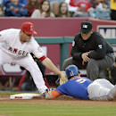 New York Mets' David Wright, right, is tagged out by Los Angeles Angels third baseman David Freese as he tries to steal third during the fourth inning of a baseball game on Saturday, April 12, 2014, in Anaheim, Calif The Associated Press
