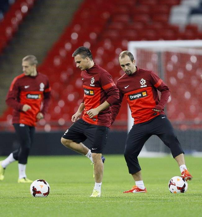 Poland's soccer team during a training session at Wembley Stadium in London, Monday, Oct. 14, 2013. England will play Poland in a World Cup Group H qualification match at Wembley stadium in London on Tuesday