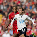 Tottenham's Christian Eriksen, right, keeps the ball from Liverpool's Glen Johnson during their English Premier League soccer match at Anfield Stadium, Liverpool, England, Sunday, March 30, 2014
