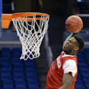 Louisville 's Montrezi Harrell dunks the ball during practice for the NCAA men's college basketball tournament in Orlando, Fla., Wednesday, March 19, 2014. Louisville plays against Manhattan in a second-round game on Thursday The Associated Press