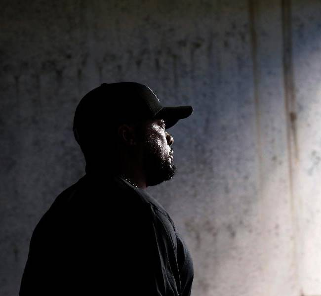 Pittsburgh Steelers head coach Mike Tomlin walks out of the visitors tunnel before an NFL preseason football game against the Philadelphia Eagles, Thursday, Aug. 21, 2014, in Philadelphia