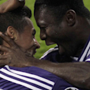 Anderlecht's Andy Najar, left, celebrates with teammate Anderlecht's Frank Acheampong after scoring the opening goal of the game during the Group D Champions League match between Anderlecht and Arsenal at Constant Vanden Stock Stadium in Brussels, Belgium