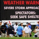 Spectators head for shelter as play is suspended during final round play in the Arnold Palmer Invitational PGA golf tournament in Orlando, Florida March 24, 2013. REUTERS/Scott Miller