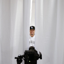 Colorado Rockies left fielder Carlos Gonzalez poses during the team photo day before a spring training baseball workout Wednesday, Feb. 26, 2014, in Scottsdale, Ariz The Associated Press