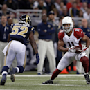Arizona Cardinals' Larry Fitzgerald (11) is tackled by St. Louis Rams' Alec Ogletree (52) during the first half of an NFL football game Thursday, Dec. 11, 2014 in St. Louis The Associated Press