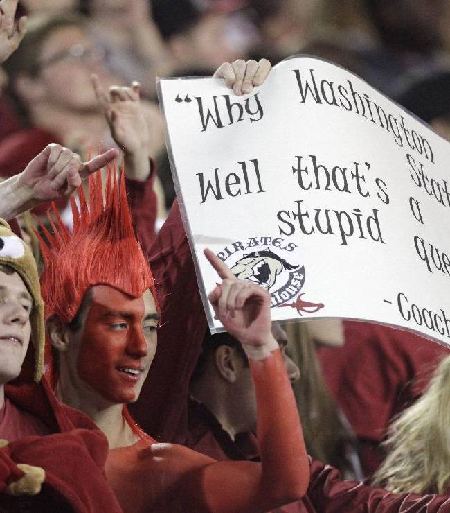 Washington State students cheer on head coach Mike Leach during the first quarter of an NCAA college football game against  Idaho on Saturday, Sept. 21, 2013, in Pullman, Wash