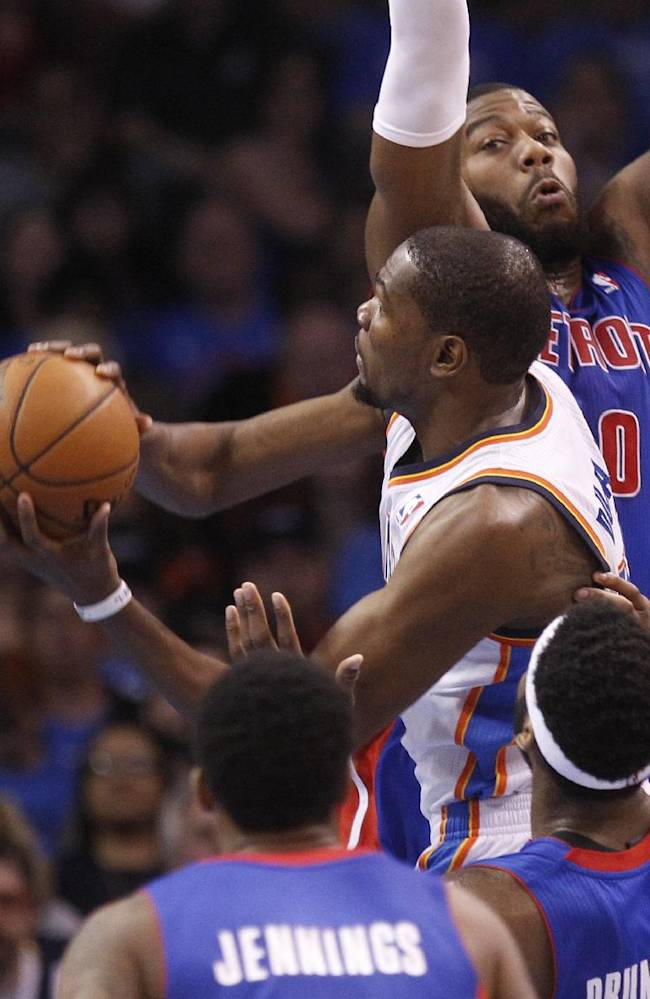 Oklahoma City Thunder forward Kevin Durant (35) goes up for a shot in front of Detroit Pistons guard Brandon Jennings, front, center Andre Drummond and forward Greg Monroe (10) during the first quarter of an NBA basketball game in Oklahoma City, Wednesday, April 16, 2014