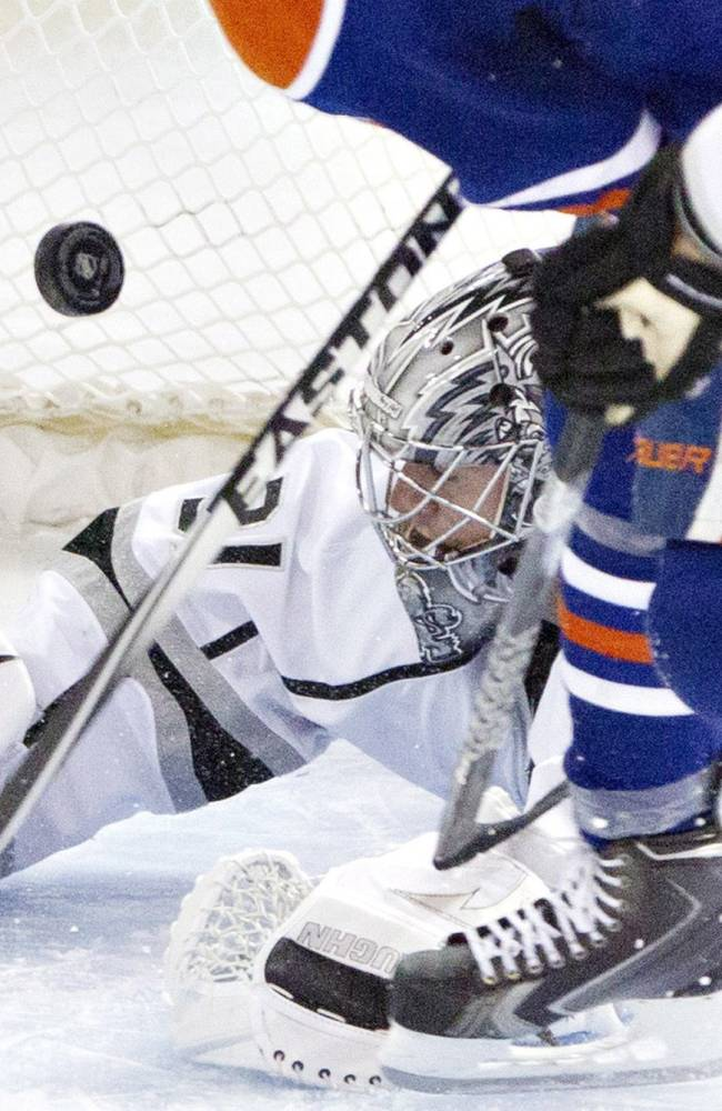 Los Angeles Kings goalie Martin Jones (31) makes the save on Edmonton Oilers' Taylor Hall (4) during second-period NHL hockey game action in Edmonton, Alberta, Thursday, April 10, 2014