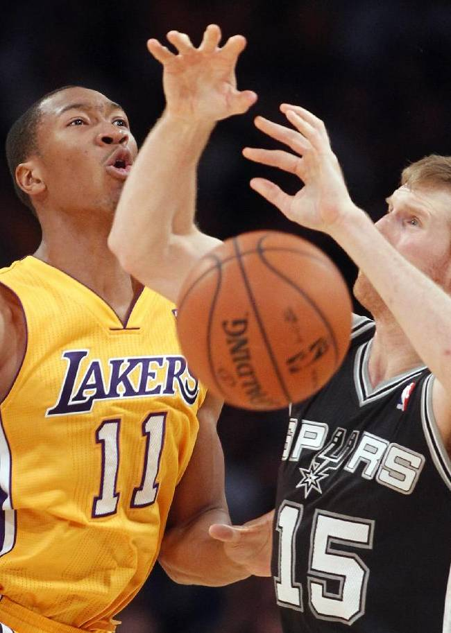 Los Angeles Lakers guard Wesley Johnson (11) knocks the ball away from San Antonio Spurs forward Matt Bonner (15) in the second quarter of an NBA basketball game Friday, Nov. 1, 2013, in Los Angeles