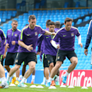 Manchester City's James Milner, centre left, and Frank Lampard, centre right, take part with other team members in a training session at the Etihad Stadium, Manchester, England, Monday Sept. 29, 2014. Manchester City face Roma in a Group E Champions Leagu