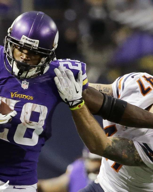 Minnesota Vikings running back Adrian Peterson, left, tries to break a tackle from Chicago Bears free safety Chris Conte during the fourth quarter of an NFL football game on Sunday, Dec. 1, 2013, in Minneapolis. The Vikings won 23-20 in overtime