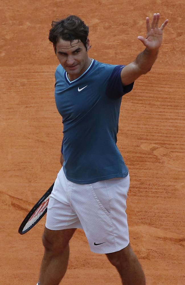 Roger Federer of Switzerland acknowledges applause after defeating Jo-Wilfried Tsonga of France during their quarterfinals match of the Monte Carlo Tennis Masters tournament in Monaco, Friday, April 18, 2014. Federer won 2-6 7-6 6-1