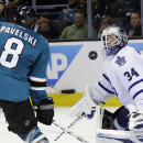 Toronto Maple Leafs goalie James Reimer (34) deflects a shot by San Jose Sharks' Joe Pavelski (8) during the third period of an NHL hockey game Tuesday, March 11, 2014, in San Jose, Calif. San Jose won 6-2 The Associated Press