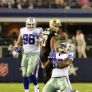 Dallas Cowboys defensive tackle Henry Melton (69) kneels to celebrate his sack against New Orleans Saints quarterback Drew Brees during the second half of an NFL football game Sunday, Sept. 28, 2014, in Arlington, Texas. The Associated Press