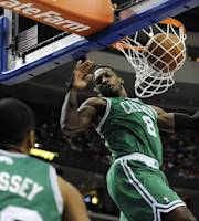 Boston Celtics' Jeff Green (8) scores on a dunks while Phil Pressey watches during the first half of an NBA basketball game against the Philadelphia 76ers on Monday, April 14, 2014, in Philadelphia. (AP Photo/Michael Perez)