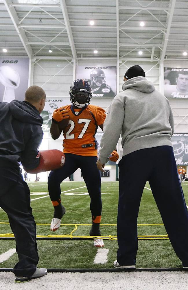 Denver Broncos running back Knowshon Moreno (27) runs a drill inside the New York Jets facility during practice Thursday, Jan. 30, 2014, in Florham Park, N.J. The Broncos are scheduled to play the Seattle Seahawks in the NFL Super Bowl XLVIII football game Sunday, Feb. 2, in East Rutherford, N.J. (AP Photo)
