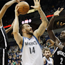Minnesota Timberwolves' Nikola Pekovic, center, of Montenegro, attempts a shot as Brooklyn Nets' Shaun Livingston, left, and Kevin Garnett defend in the first quarter of an NBA basketball game Friday, Nov. 22, 2013, in Minneapolis The Associated Press