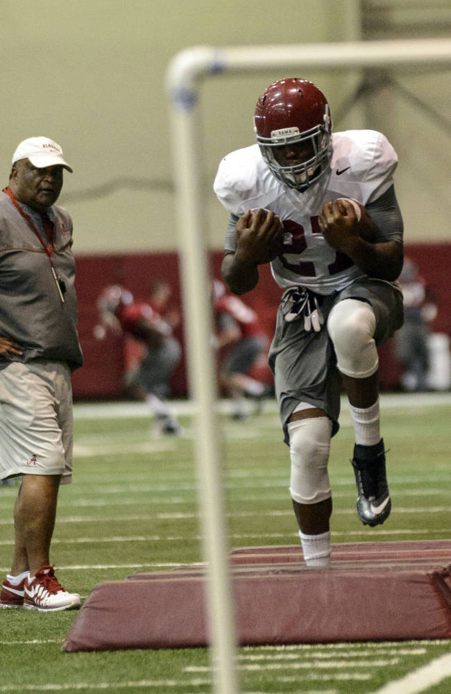 Alabama running back Derrick Henry (27) works through running back drills during NCAA college football practice on Friday, April 4, 2014, in Tuscaloosa, Ala