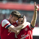 Arsenal's Mikel Arteta celebrates with teammate Olivier Giroud, after scoring against Everton, during their FA Cup quarterfinal soccer match, at Emirates Stadium, in London, Saturday, March 8, 2014