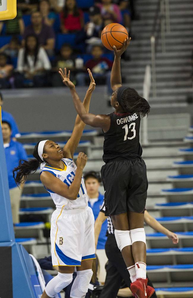 Stanford forward Chiney Ogwumike, right, who scored a game-high 26 points, shoots over  UCLA forward Atonye Nyingifa, left, in the second half of an NCAA college basketball game, Sunday, Feb. 23, 2014 in Los Angeles. Stanford won 65-54
