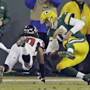 Green Bay Packers' Aaron Rodgers loses the ball in front of Atlanta Falcons' Dwight Lowery as he scrambles during the first half of an NFL football game Monday, Dec. 8, 2014, in Green Bay, Wis The Associated Press