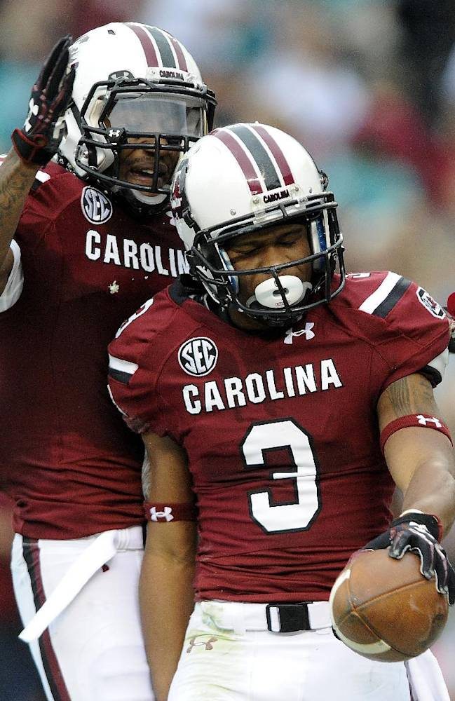 South Carolina wide receiver Nick Jones (3) celebrates after scoring a touchdown with teammateShaq Roland (4) during the first half of an NCAA college football game against Coastal Carolina, Saturday, Nov. 23, 2013 in Columbia, S.C