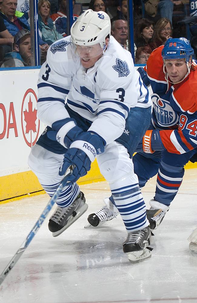 EDMONTON, CANADA - FEBRUARY 15: Dion Phaneuf #3 of the Toronto Maple Leafs protects the puck from a forechecking Ryan Smyth #94 of the Edmonton Oilers at Rexall Place on February 15, 2012 in Edmonton, Alberta, Canada. (Photo by Andy Devlin/NHLI via Getty Images)