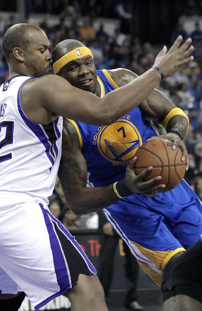 Golden State Warriors center Jermaine O'Neal, right, goes to the basket against Sacramento Kings forward Chuck Hayes during the first quarter of an NBA basketball game in Sacramento, Calif., Sunday, Dec. 1, 2013