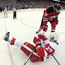 In this photograph taken with a fisheye lens, New Jersey Devils right wing Dainius Zubrus (8), of Lithuania, and Detroit Red Wings defenseman Kyle Quincey (27) get tangled up in the corner during the second period of an NHL hockey game, Friday, Nov. 28, 2