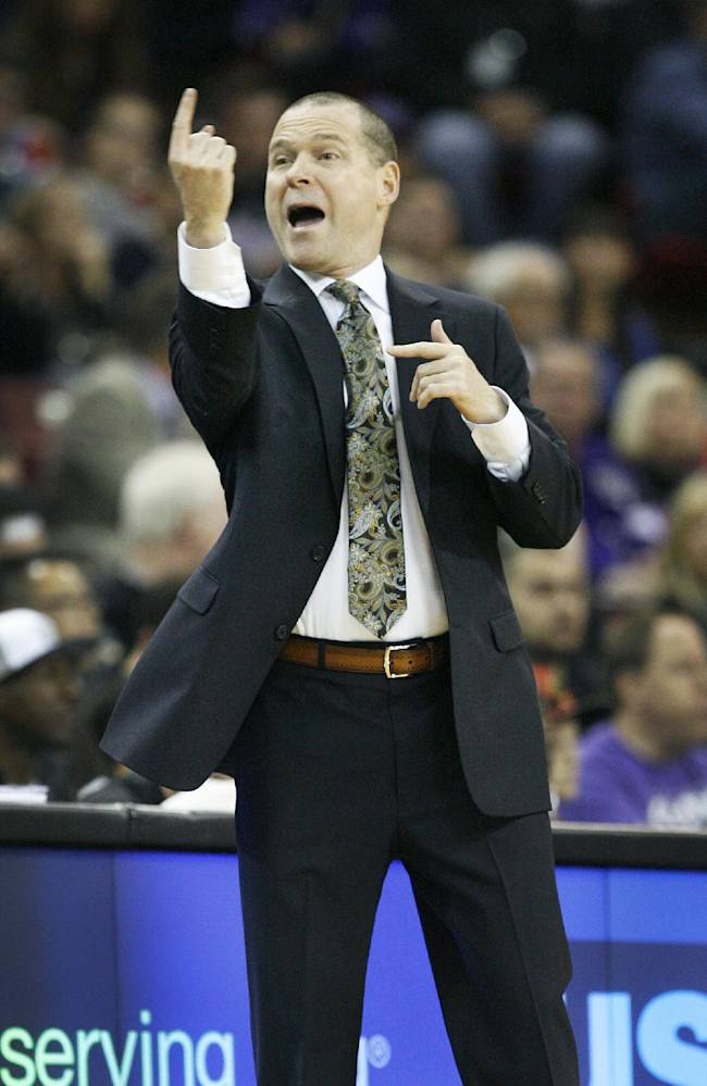 Sacramento Kings head coach Michael Malone directs his players against the Philadelphia 76ers during the first half of an NBA basketball game in Sacramento, Calif., on Thursday, Jan. 2, 2014