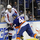 New York Islanders' Calvin de Haan (44) slams Washington Capitals' Alex Ovechkin (8) into the boards in the first period of an NHL hockey game on Saturday, April 5, 2014, in Uniondale, N.Y. The Capitals won 4-3 in a shoot out The Associated Press