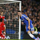 Chelsea s Gary Cahill runs to celebrate after scoring his team s first goal against Southampton during their English Premier League soccer match at the Stamford bridge ground in London, Sunday, Dec. 1, 2013