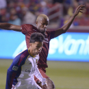 Sacramento Republic FC midfielder Gilberto Souza, rear, tries to get to the ball against Real Salt Lake midfielder Sebastian Velasquez during an exhibition soccer game in Sandy, Utah, Tuesday, Sept. 30, 2014 The Associated Press