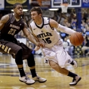Butler guard Rotnei Clarke, right, drives on St. Bonaventure forward Chris Johnson in the second half of an NCAA college basketball game in Indianapolis, Wednesday, Feb. 6, 2013. Butler won 77-58. (AP Photo/Michael Conroy)