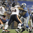 In this Oct. 10, 2011 file photo, Detroit Lions defensive tackle Nick Fairley (98) tries to get past Chicago Bears guard Chris Williams (74) as Chicago Bears quarterback Jay Cutler (6) drops back in the fourth quarter of NFL football game in Detroit. The