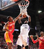 HOUSTON, TX - DECEMBER 31: DeMarcus Cousins #15 of the Sacramento Kings shoots against Terrence Jones #6 of the Houston Rockets on December 31, 2013 at the Toyota Center in Houston, Texas. (Photo by Bill Baptist/NBAE via Getty Images)