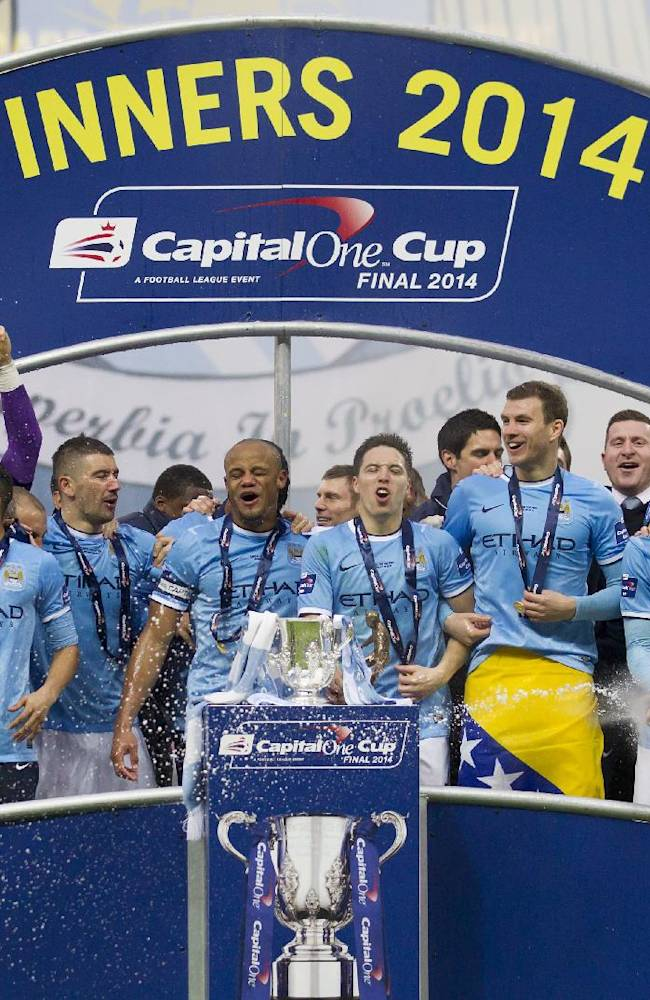 Manchester City players celebrate after their 3-1 win against  Sunderland in the League Cup Final at Wembley Stadium, London, England, Sunday, March 2, 2014