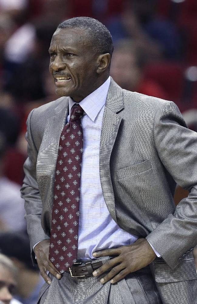 Toronto Raptors coach Dwane Casey talks to his players in the first half of an NBA basketball game against the Houston Rockets  Monday, Nov. 11, 2013, in Houston