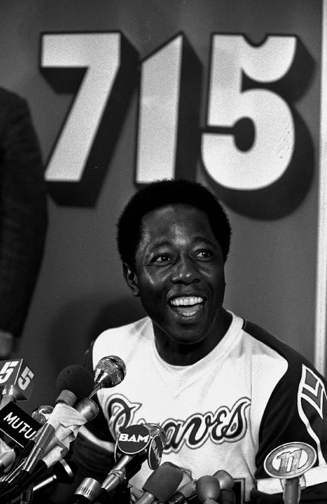 In this April 8, 1974 file photo, Atlanta Braves baseball player Hank Aaron speaks during a press conference after hitting his 715th home run during a game against the Los Angeles Dodgers, in Atlanta. The 40th anniversary of Hank Aaron's 715th home run finds the Hall of Famer, now 80, coping with his recovery from hip surgery. The anniversary of his famous homer on April 8, 1974 will be celebrated before the Braves' home opener against the Mets on Tuesday night, April 8