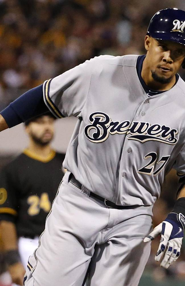 Milwaukee Brewers' Carlos Gomez rounds third after hitting a solo home run off Pittsburgh Pirates starting pitcher Charlie Morton during the fifth inning of a baseball game in Pittsburgh on Friday, April 18, 2014